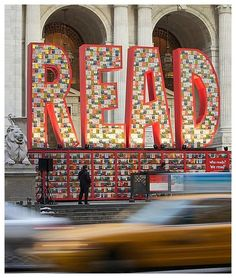 """The Target Corporation has banded with the New York Public Library to help advocate children's literacy. As part of the New York City Read Across America event, a giant red display of """"READ"""" — made entirely from Dr. Seuss books between the library's iconic lion statue.  The epic READ sculpture, designed by David Stark, was made of 25,000 Dr. Seuss books, which were then generously donated to public schools across New York."""