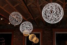15 Cheap DIY Wedding Decorations These string balls would make a beautiful touch to an evening wedding.