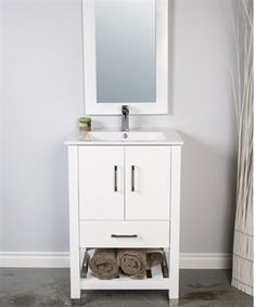A 24 inch bathroom vanity with open bottom shelf for towels or basket.  This vanity has a single piece integral sink.