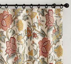 What about something like this, that would tie all the colors of the floor together? Cynthia Palampore Drape #potterybarn