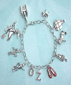 This charm bracelet features The Wizard of Oz inspired Tibetan silver charms. Each charm is attached to a silver tone bracelet that measures 7.5 inches in length. SKU 1563
