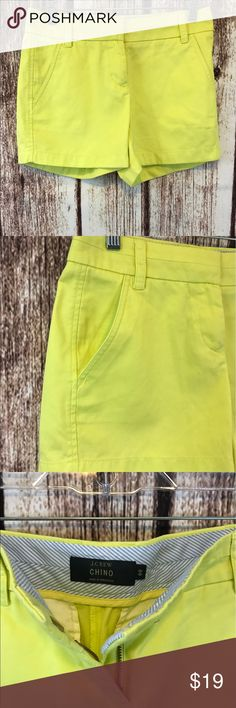 "J.crew neon yellow/ green chino shorts Nice pair of chino neon green /yellow shorts in great condition size 00 100% cotton  15"" flat 12 1/2 long J. Crew Shorts"