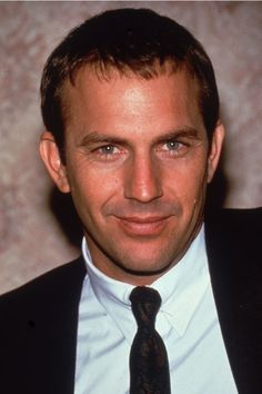 """Between Robin Hood: Prince of Thieves, JFK, and The Bodyguard (the latter in 1992), the top of the '90s were basically Kevin Costner's world, and we were just living in it. Straddling the worlds between action, drama, and romance, he played smart in defining himself as an undefinable actor. But above all, he carried Whitney Houston offstage, making """"I Will Always Love You"""" the most important song of all school dances."""
