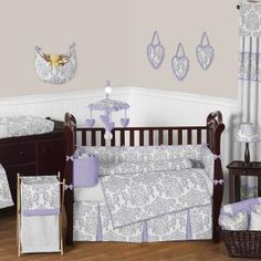 Lavender and Gray Elizabeth 9 pc Crib Bedding set has all that your little bundle of joy will need. Let the little one in your home settle down to sleep in this incredible nursery set. This baby bedding set features a gorgeous Sweet Jojo Designs damask print. This collection uses the stylish colors of lavender, gray and white.