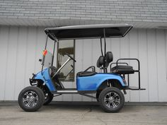 Another custom golf car to leave our shop this week. This lifted E-Z-GO PDS features a blue body, extended hard top, custom graphite seats, alloy wheels, carbon dash kit, Pyle stereo, custom steering wheel, front brush guard, and more.