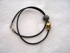 Brass skull and faceted stone leather wrap bracelet by honeywild $36