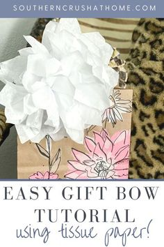 This DIY bow is the perfect addition to any gift bag or box! Learn how to create this beautiful bow in a few easy steps with this fun DIY tutorial! #bows #giftbow #tissuepaper #papercraft #DIYgift #giftidea
