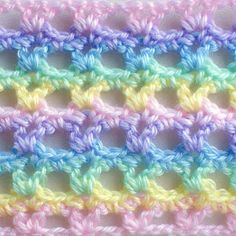 """Lacy Interruted V-Stitch in a Rainbow of Bernat Softee Pastels  crochet afghan for baby  pastel rainbow - it looks like """"Simply Soft"""" yarn would have the same texture"""