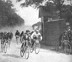 Cyclists riding the first Tour de France, in 1903. Notice the outfits! Maurice Garin, here in white, won the Tour.