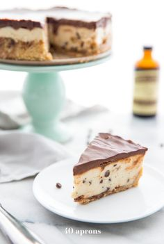 This vegan no bake cookie dough cheesecake is paleo and free of refined sugars but totally loaded with taste. With a tangy-sweet cheesecake filling, reminiscent of spoonfuls of cookie dough and dotted with chocolate chips, this vegan no bake cookie dough cheesecake is the perfect vegan no bake dessert. With a chocolate chip crust and ganache topping, you'd never know this paleo no bake cookie dough cheesecake is healthy! #vegan #paleo #cookiedough #raw #nobake #vegandesserts #paleodesserts