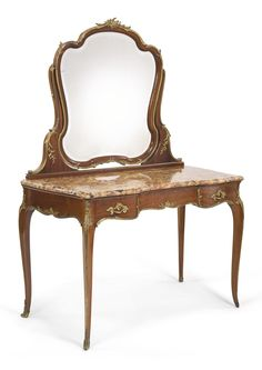François Linke French, 1855 - 1946 A gilt bronze mounted mahogany dressing table Paris, early 20th Century