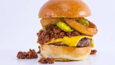 Chili Cheeseburger  This burger-with-the-works gets topped with chili, pickled jalapenos, and onion rings.