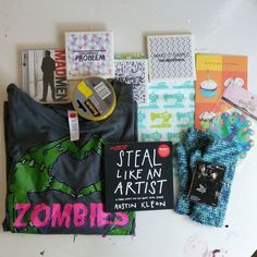 My last #bestbirthdayeverswap package came from @momoffire and its another amazing box of goodies!!! Zombie shirt mad men CD!!! tape tilesthread organizer handmade wristlits Halloween charms super cute sewing machine fabric and Steal Like an Artist book.  Another thing I've been eyeballin but haven't picked up.  Thank you so much @momoffire !!!!