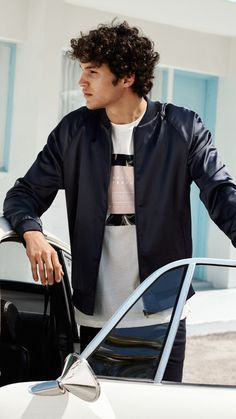 The season's top trends for menswear? Embroidered souvenir jackets, short-sleeved shirts and athleisure staples. | H&M For Men