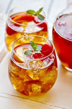 Sweet tea sangria with raspberries and fresh summer peaches! This is a great cocktail for entertaining!