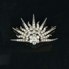 A diamond rising sun royal presentation brooch, circa 1895, set throughout with old brilliant and rose-cut diamonds,