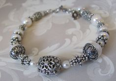 BALI BEAD FOCAL..............................THEN USE SWAROVSKI AND BEAD CAPS FOR COLORS.....................Sterling Silver ARTISAN Freshwater Pearl and Bali by AlexUdesigns