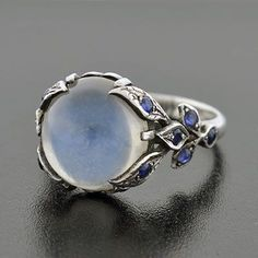 A Brandt and Son - Vintage Sterling Moonstone Cabochon & Sapphire Ring...pinned by ♥ wootandhammy.com, thoughtful jewelry.