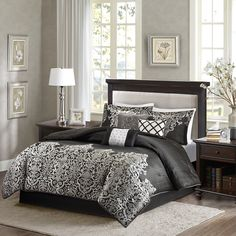 Create an opulent look in your master bedroom with the Madison Park Vanessa Comforter Set. The woven jacquard design provides texture in the solid black portion while a the decorative motif comes up from the bottom of the bed to the center. Three decorative pillows use pleating and embroidery to add value to the top of bed.