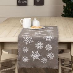 The Snowflake Burlap Grey Runner dresses your table for the winter season. Enjoy this neutral grey runner during Christmas and into the new year. This snowy runner looks great with most decor styles. Put it on your dining table, coffee table, or even a side table to add Christmas flair to your home. 100% cotton. Featur