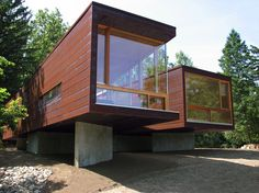 At 1,100 square feet, a modular prefab home in Michigan follows the gentle slope of the land, with large windows that allow in ample light.