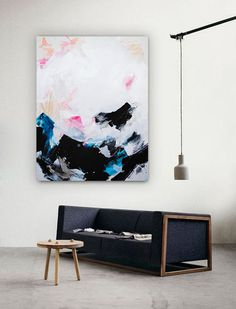 Colorful abstract painting styled in a contemporary space. This original is available online only. Shop the link below