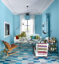 Tiled floors in blue living room with colorful throw blanket