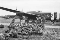 Paratroops of 22 Independent Parachute Company, British 6th Airborne Division, waiting to board the Armstrong Whitworth Albemarle Mk V that will drop them over Normandy, RAF Harwell, 5 June 1944.