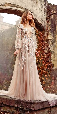 The detailed embroidery and blush tones make this vintage dress an absolute head-turner!