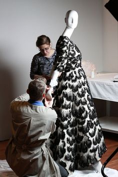 Balenciaga Installation 2011:  Independent contractor Glenn Petersen and former staff conservator Beth Szuhay working as a team to dress this mannequin.