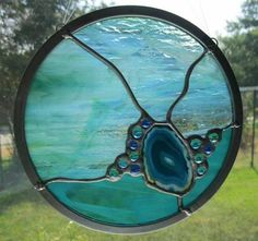 Abstract Round Stained Glass Panel - Aqua Blue with Agate Slice and Glass Nuggets  Nanantz- Stained glass panels and suncatchers handmade in Texas