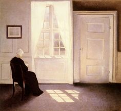 Vilhelm Hammershøi (Danish, 1864-1916). A Woman Reading by a Window. Oil on canvas