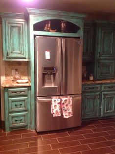 Love the cabinets! Love what's over the fridge