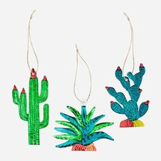 Totally obsessed with these cactus and succulent tin christmas tree ornaments. Handmade and handpainted in Mexico. Shop Christmas tree decorations at Rock N Rose!