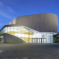 A strip of glazing interrupts the seamless surfaces of this cultural centre by Hascher Jehle Architecture for a site in the Austrian city of Feldkirch