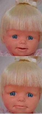 I loved my cheerful tearful baby doll. She used to have such cute hair... before I washed it. And bleached it.