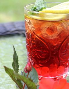 Boston Iced Tea~~cranberry juice and sweet tea with garnishes of mint and lemon slices.  Sounds refreshing