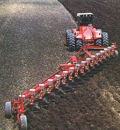 Nowdays ya have a big tractor plowing