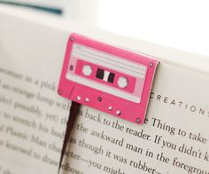 Just when you thought they had gone the way of the dodo bird, cassette tapes are back in action! The cassette tape bookmarks slide over the desired page and let their long tape hang down so that you can quickly pick up where you last left off.