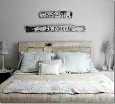 LOVE the re-purposed old door as a headboard! I'm thinking I like this idea for my boy's room!