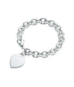I have this......Tiffany & Co. Heart Tag Charm Bracelet #monogram O Want matching ones for me and the girls