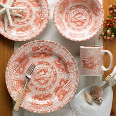 Mottahedeh Coral Torquay Dinnerware: Mottahedeh's latest interpretation of the Winterthur Museum Torquay pattern. The original blue and white Swansea pattern, circa 1820. was named after the elegant resort town of Torquay on the southern coast of England, renowned for its climate and it�s abundant marine life.  Mottahedeh has given this classic a fresh new look. Coral evokes a sense of tranquility and the beach at sunset. These plates are dishwasher safe.