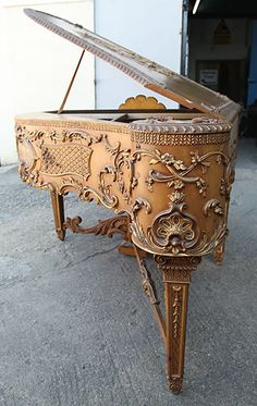 Extremely Rare, Claviano Grand Piano: Ornately Carved, Rococo Style Case with Gilt Detail & Hand Painted Panels.Reputedly Built for Songwriter & Film star Ivor Novello. The Keyboard Spans 5 1/2 Octaves & Has Been Strung Using Bichords.
