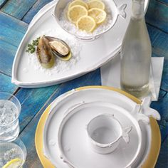 Fresh Fish by Vietri.  Simple fish shapes in clean white with rustic edges create a fresh and playful table. Handmade in Tuscany of Italian stoneware.  How fun!