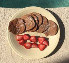 Healthy Pancakes: Ripe Bananas, Egg Whites, Coconut Milk, Vanilla Extract, Cinnamon, Oat Flour, Chia Seeds, Cocoa Powder, Shredded Coconut, Strawberries on side
