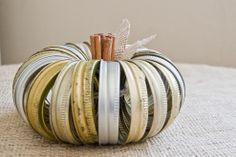 Been busy canning as fall draws nearer? Need to make a quick centerpiece or want an easy seasonal decor project after spending hours preserving summer's bounty? A 'Canning Jar Ring Pumpkin' is a great & inexpensive option!