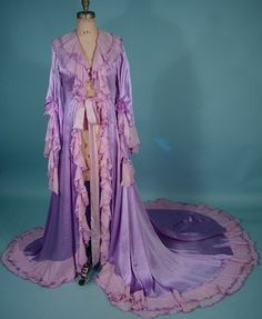 Antique pastel pink & lilac purple silk charmeuse peignoir dressing gown with tiered ruffles, angel wing sleeves, & chiffon bows (circa 1900).