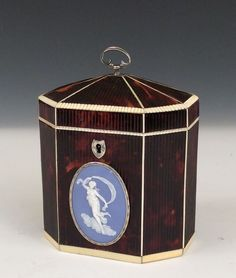 VERY RARE RIBBED TORTOISESHELL TEA CADDY // A very rare octagonal ribbed tortoiseshell tea caddy with ivory stringing and facings with a silver ring handle, silver key escutcheon and a large oval Wedgwood plaque with a silver surround. Height: 5 ins / 12.7 cms Width: 4 ins / 10.16 cms Depth: 2.75 ins / 6.99 cms //  Price: £7750 //  - Maria Elena Garcia -  ► www.pinterest.com/megardel/ ◀︎