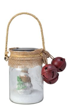 Jingle Bells!  Jingle Bells!  Frosty is ready for a sleigh ride with this rustic jar decoration from Moonrays.