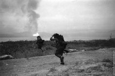 Marines under fire on Wolmi-do, September 15, 1950. A burning Inchon is visible in the background